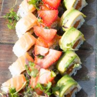 Image of Fresh Sushi with Avocado and Strawberries by Yooshi Sushi